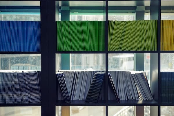 Organized files and documents on shelves